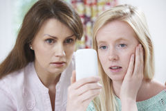 Mother Comforting Daughter Being Bullied By Text Message Stock Images