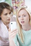 Mother Comforting Daughter Being Bullied By Text Message Royalty Free Stock Photos