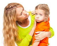 Mother comforting daughter Stock Images