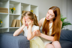 Mother comforting daughter. Mother comforting her teenage daughter at home Royalty Free Stock Photography
