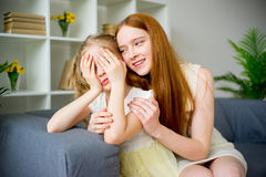 Mother comforting daughter Stock Photos