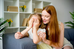 Mother comforting daughter. Mother comforting her teenage daughter at home Royalty Free Stock Images