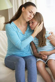 Mother Comforting Daughter At Home Royalty Free Stock Photos