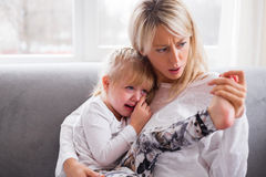 Mother comforting her crying child Royalty Free Stock Images