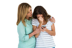 Mother comforting her daughter Stock Images