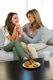 Mother comforting her daughter. At home Stock Photo