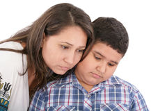 Mother comforting her son. Isolated Stock Images