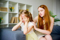 Mother comforting daughter. Mother comforting her teenage daughter at home Royalty Free Stock Photo