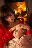 Mother Comforting Sick Daughter Stock Photography