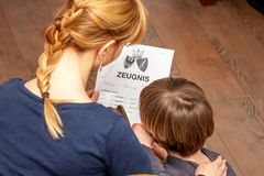 Mother comforting son despite the bad school certificate - Translation: certificate day of birth disciplines music
