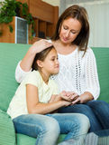 Mother comforting teen. Mother comforting sad teen daughter at home Stock Images