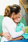 Mother comforting teenage boy Royalty Free Stock Images