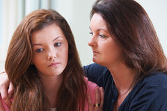 Mother Comforting Teenage Daughter. At Home Royalty Free Stock Photos