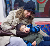 Mother Comforting Young Son. Mother and son riding on an underground train Royalty Free Stock Photography
