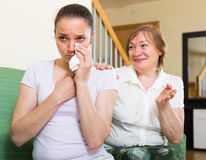Mother comforts adult daughter Stock Photo