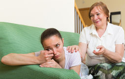 Mother comforts adult daughter Royalty Free Stock Image