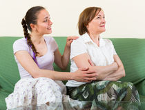 Mother comforts daughter at home Royalty Free Stock Photography