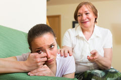Mother comforts  daughter   at home Stock Photography