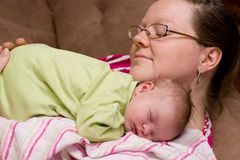 Mother Comforts Sleeping Baby Girl Royalty Free Stock Photos