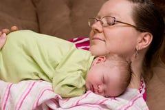Mother Comforts Sleeping Baby Girl Royalty Free Stock Photos