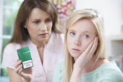 Mother Confronting Daughter Over Dangers Of Smoking. Angry Mother Confronting Daughter Over Dangers Of Smoking Royalty Free Stock Photography