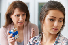 Mother Confronting Daughter Over Dangers Of Smoking Royalty Free Stock Photos