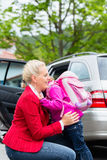 Mother consoling daughter on first day at school Stock Images
