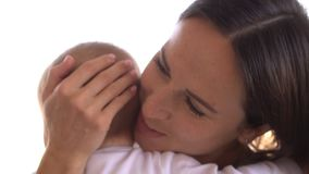 Mother comforting crying baby girl stock video footage
