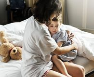 Mother consoling her son from a nightmare Stock Photos