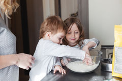 Mother cooking with children stock photos