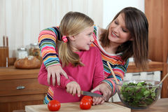 Mother cooking with daughter Stock Photography