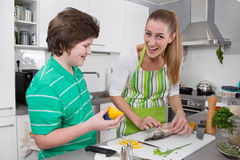 Mother cooking with her son in the kitchen - family life Stock Images