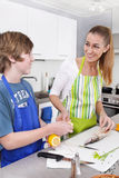 Mother cooking with her son in the kitchen - family life. Royalty Free Stock Photography