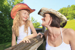 Mother cowgirl with his daughter Stock Images