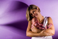 Mother cradling newborn. Happy mother with her newborn Stock Photography