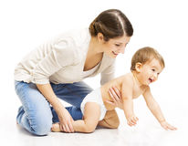 Mother and Crawling Toddler Kid, Woman Parent Holding Child. In Diaper Over White background royalty free stock images