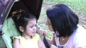 Mother with crying baby outdoors stock video