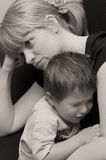 Mother and crying child. Monochrome portrait of mother with her crying child Royalty Free Stock Photography