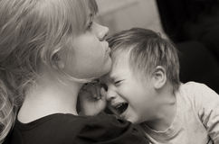 Mother and crying child. Monochrome portrait of mother with her crying child Stock Photography