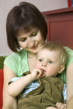 Mother cuddle her blond baby Royalty Free Stock Photos