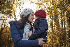 Mother Cuddling Daughter On Walk In Autumn Countryside Royalty Free Stock Photography