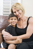 Mother cuddling her son Royalty Free Stock Photos