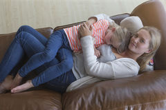 Mother cuddling sleepy daughter Royalty Free Stock Photography