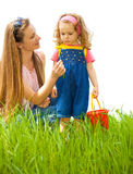 Mother and curly girl Royalty Free Stock Images