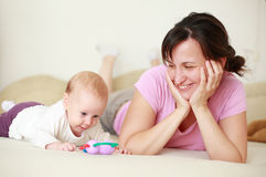 Mother with cute baby on bed Royalty Free Stock Image