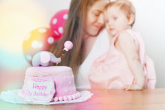 Mother with cute baby celebrating first birthday. Cake. Royalty Free Stock Photo
