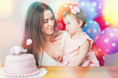 Mother with cute baby celebrating first birthday. Cake. Stock Photography