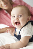 Mother With Cute Baby Girl Playing On Bed Royalty Free Stock Photos