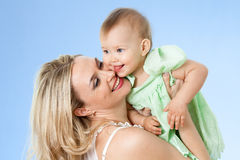 Mother with cute baby looking over shoulder. Mother with cute baby girl looking over shoulder Stock Images