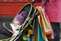 Mother With Cute Baby In Stroller Stock Photography